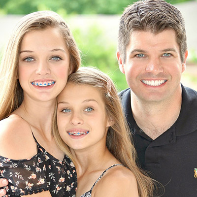 Dr. Wigal and his daughters