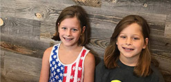 Two young girls with phase 1 orthodontics