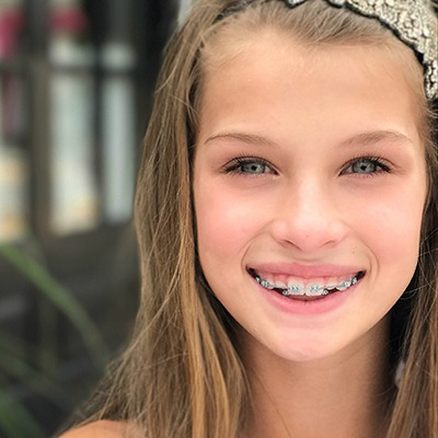 Preteen girl with braces