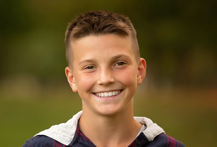 Boy with healthy straightened teeth