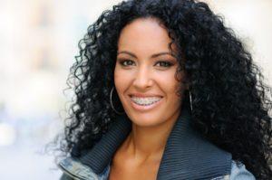 pretty woman smiling wearing braces