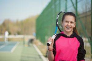 girl braces tennis