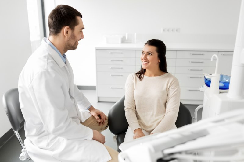Orthodontist talking to patient at appointment